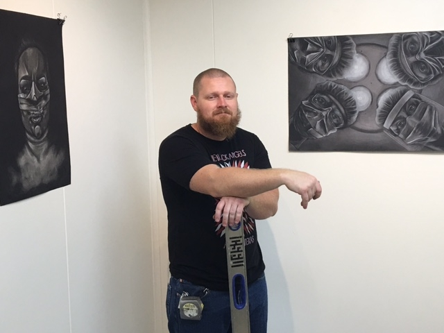 Cory Slawson installing the exhibitions, 4-16-16