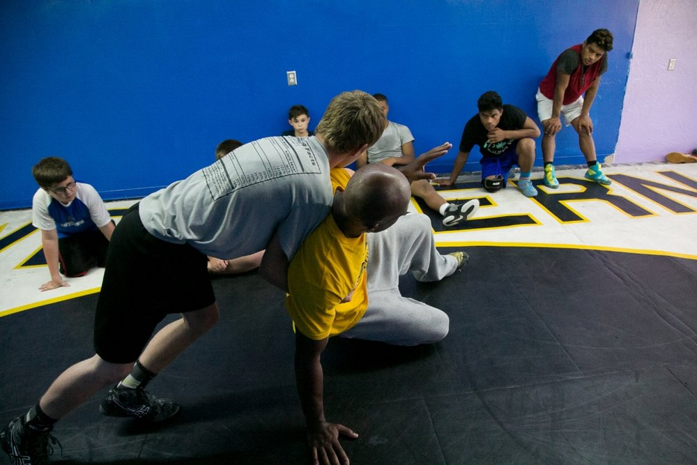 Thompson demonstrating a defensive move to his students.