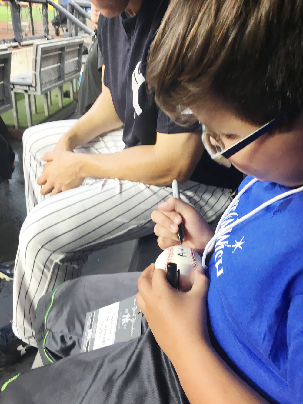 Yankee right-fielder,Aaron Judge asks Aiden to autographs a baseball for him.