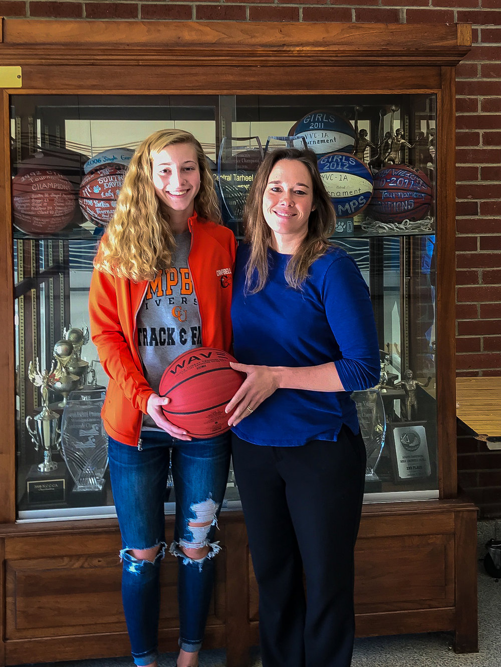 Cranford (left), a four-year varsity basketball player, with head coach Kim Frizzell.