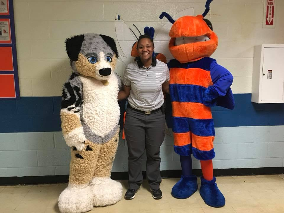 Anderson with the Lexington Senior High School and the Brenner Children's Hospital mascots.  Photo courtesy of WFBH-LMC.