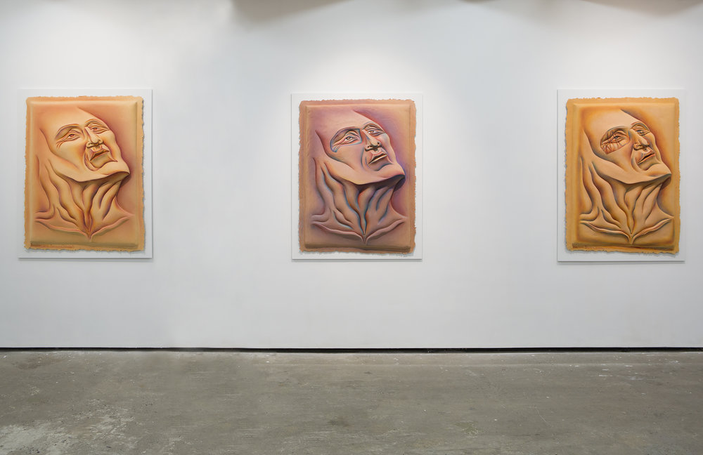 Judy Chicago -  Woe/Man with Burning Throat #10 , 1986, sprayed acrylic and oil on hand-cast paper, framed dimensions: 59 5/8 x 47 1/2 x 5 5/8 inches (151.4 x 120.7 x 14.3 cm) (left). Judy Chicago -  Woe/Man with Blue Eye #9 , 1986, sprayed acrylic and oil on hand-cast paper, framed dimensions: 58 3/4 x 46 3/4 x 5 5/8 inches (149.2 x 118.7 x 14.3 cm) (centre). Judy Chicago -  Woe/Woe Bloody Man #8 , 1986, sprayed acrylic and oil on hand-cast paper, framed dimensions: 60 7/8 x 47 1/4 x 5 5/8 inches (154.6 x 120 x 14.3 cm) (right). Image courtesy Salon 94.