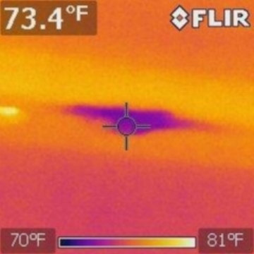 Infrared cameras measure the differences in heat at a location and the surrounding area. This picture is of a leak from an upstairs bathroom. This cannot been seen with the naked eye and the moisture content was measured with a moisture meter. The moisture is on the interior of the sheetrock so it cannot be identified by touch.