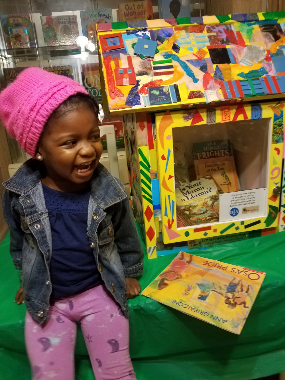 Zuri Hudson, after filling her little library with books at her home in Detroit.