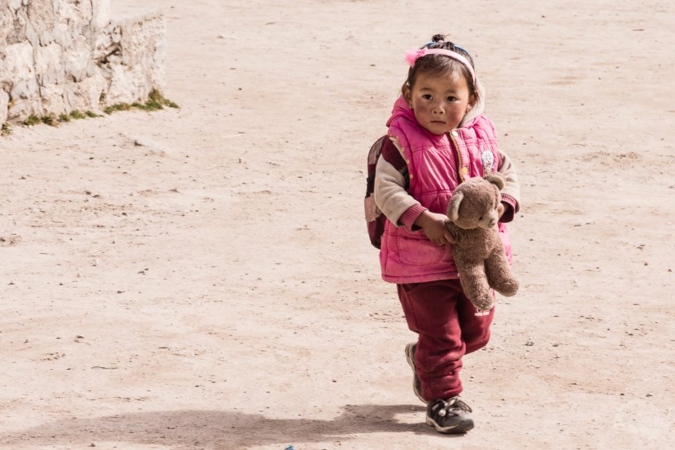 Little girl walking inside the Edmund Hillary school - Photo by Hoang Le Giang