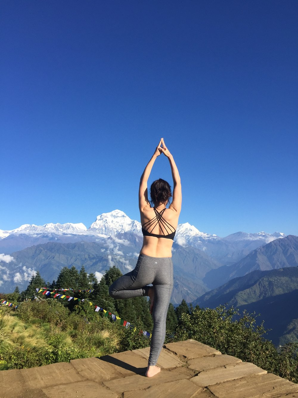 Yoga tree pose in poon hill