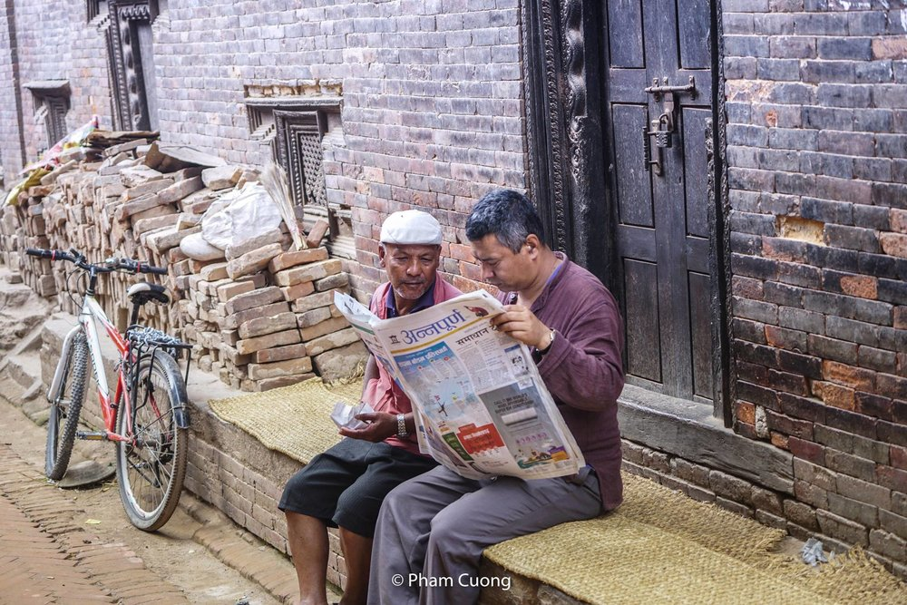 Life on the street of Bhaktapur Durbar Square - Photograph by Pham Cuong