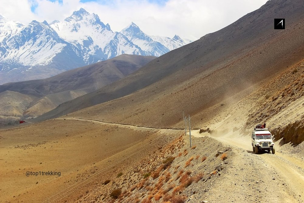 Driving through a moonlike landscapes - Upper Mustang jeep trip