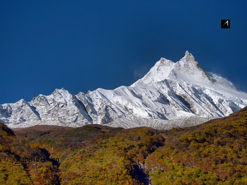 Double summit of Manaslu soaring above the sky