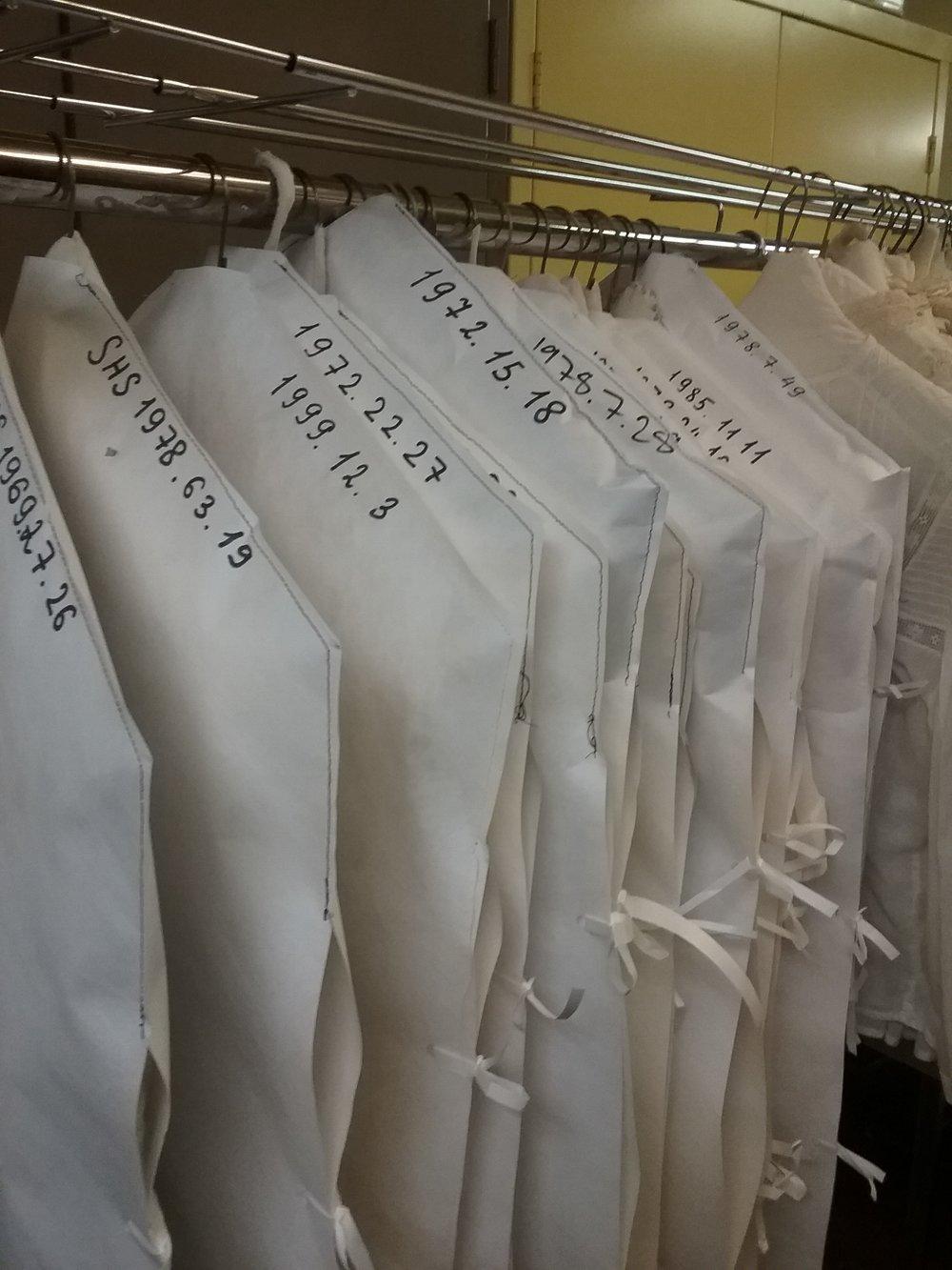 Garments inside Tyvek covers.jpg