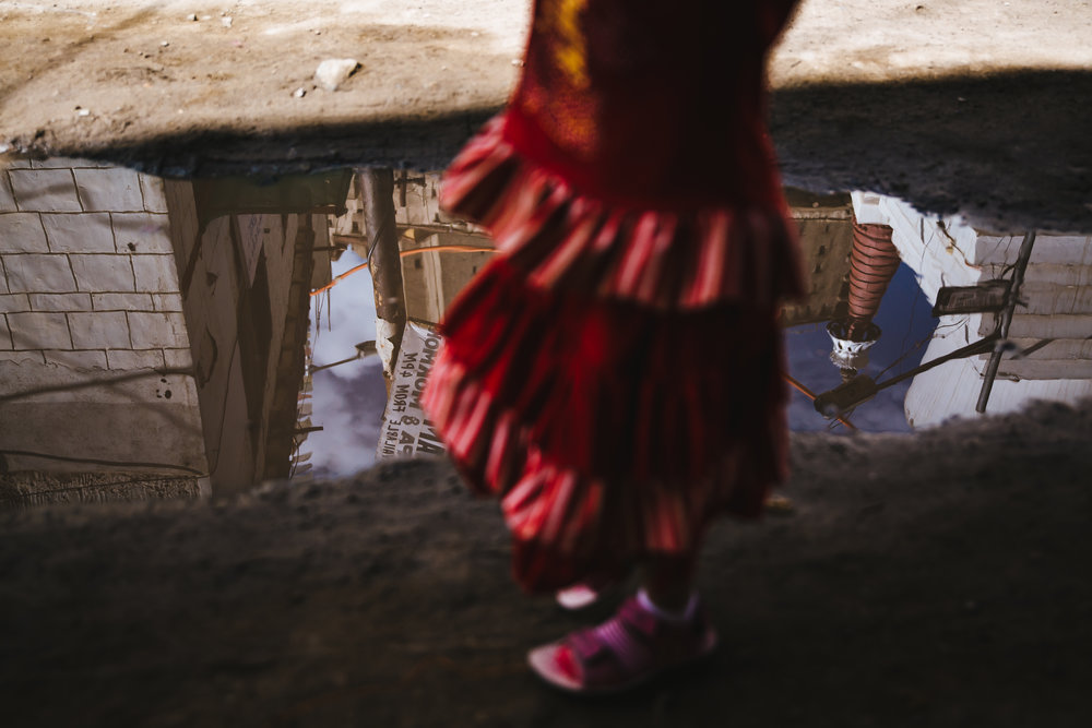 editorial-leh-girl-puddle