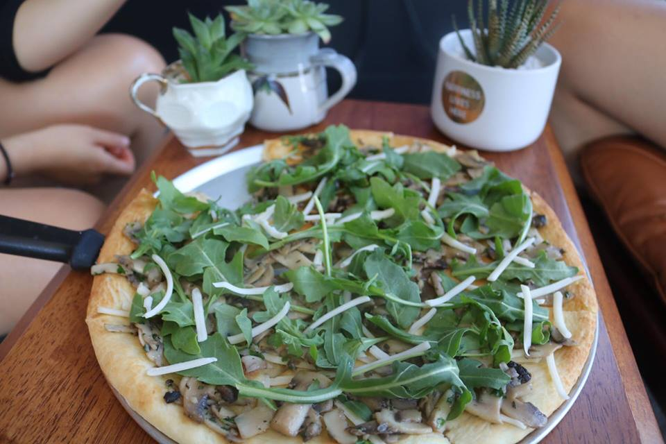 Schiacciata Fungi   Sautéed mushroom, garlic, and rocket, lightly sprinkled with vegan cheese.