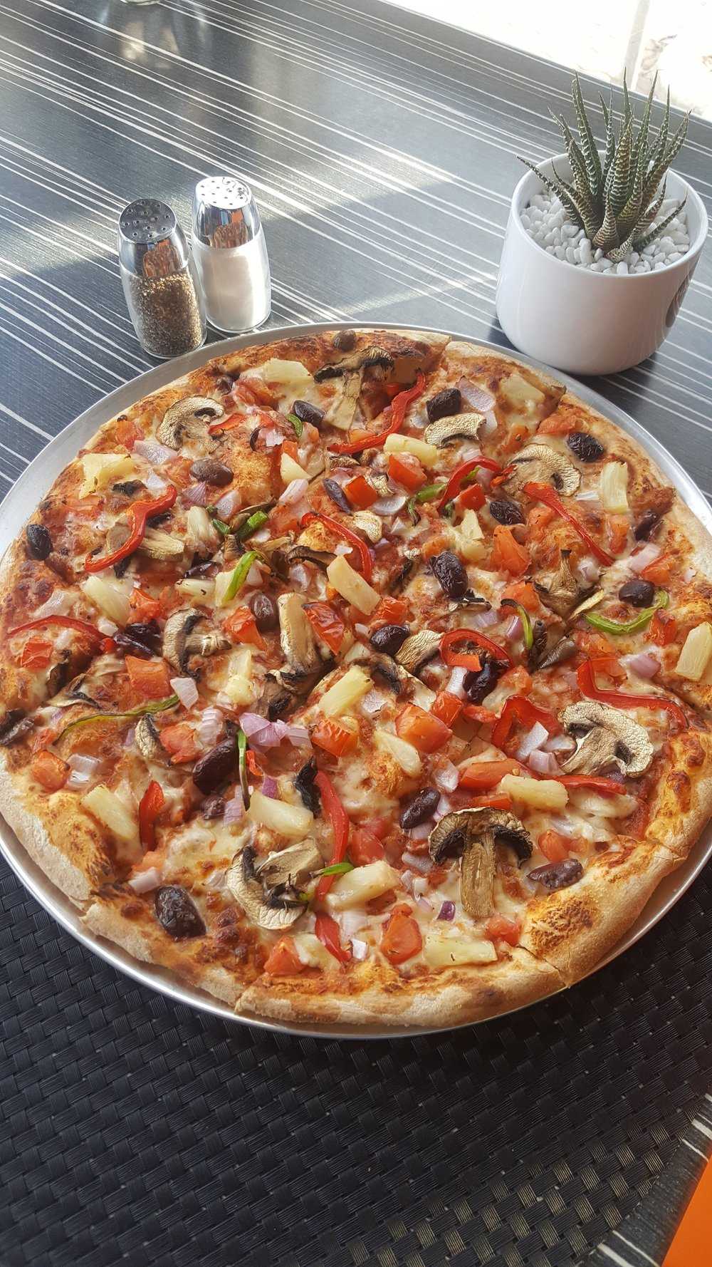Vegolovers   Our classic vegetarian pizza - but now with the option of vegan cheese!  Fresh tomato and capsicum alongside red onion, mushroom, pineapple and olives.