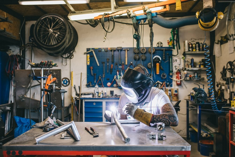 Small business owner manufacturing a bike.