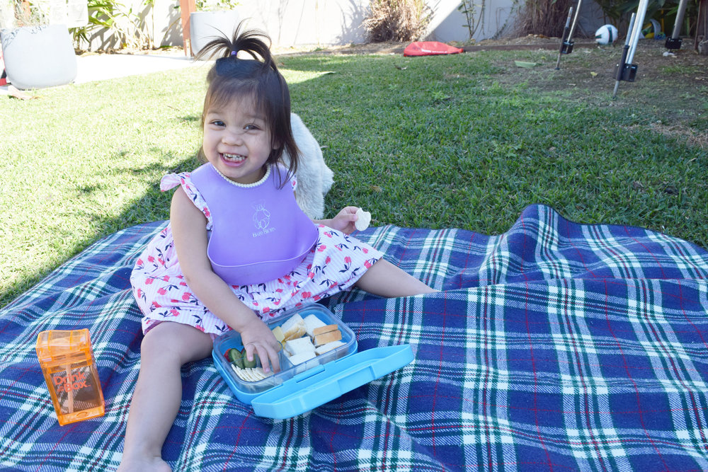 Two-year-old Clara enjoying her delicious lunch from her Yumbox lunchbox.  Photo: Grace Holgate