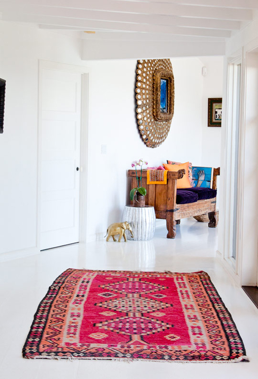 white hallway with colourful rug.jpg