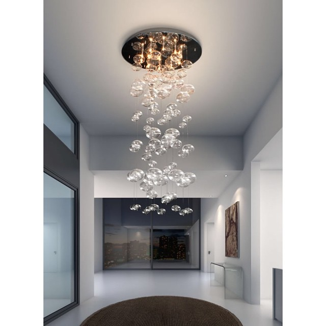 A very simple interior can be brought to life with elaborate statement lights, you really don't need anything else!