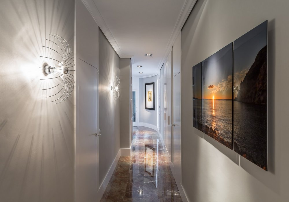 Wall lights work really well in hallway design and add instant interest