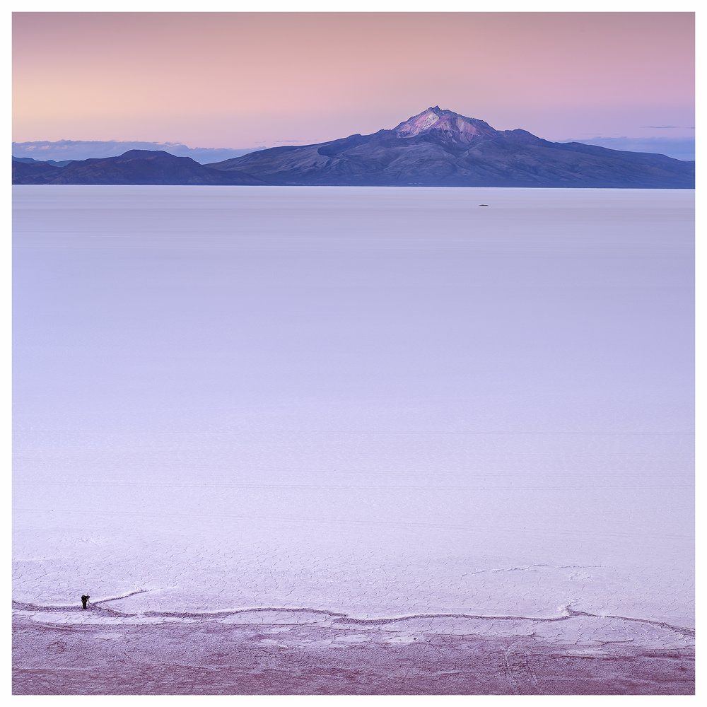 - In this image of the Salar de Uyuni in Bolivia I have placed the lone photographer way down in the corner. I feel this gives the image a good anchor point and the line or pattern he is photographing helps to lead you over to the volcano in the distance and then back again. I found this relationship between the two components did not work aswel in any other aspect ratio.