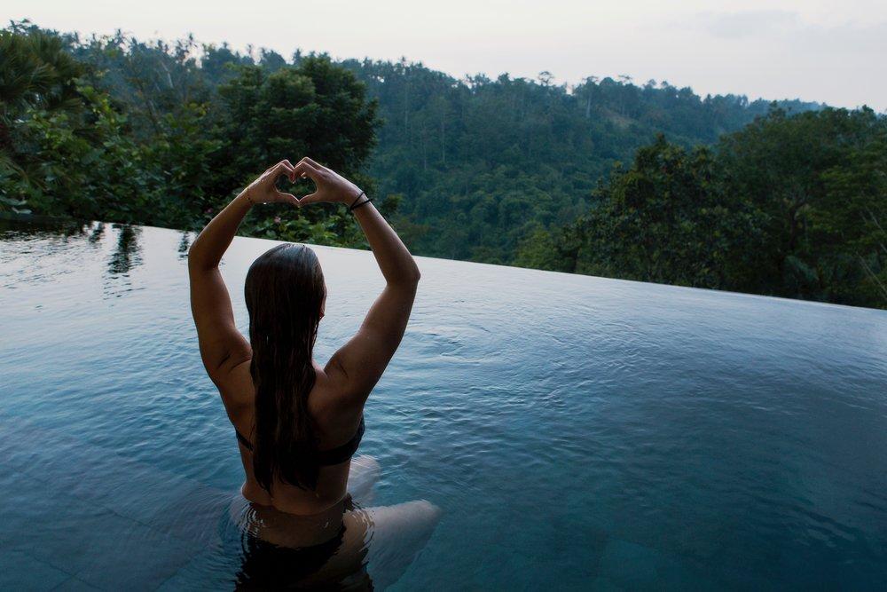 Yoga woman water trees.jpg