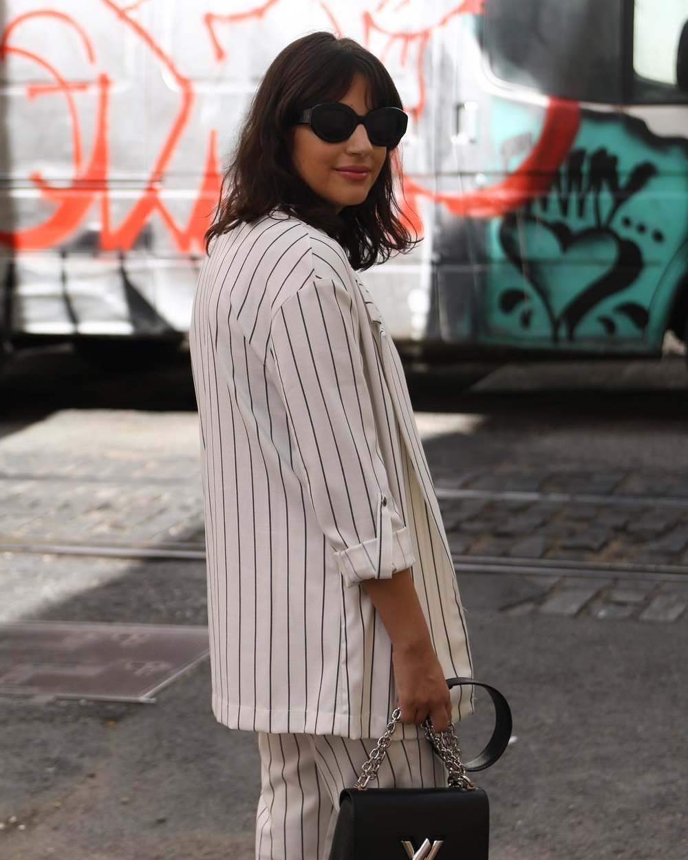 Mafalda Nunes with Darkside Ophelia Black Sunglasses in suit to work
