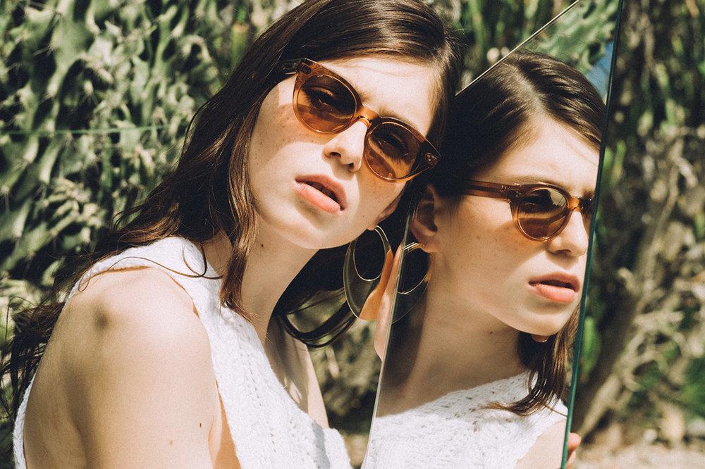 Darkside Eyewear Rhea Champagne sunglasses in the garden