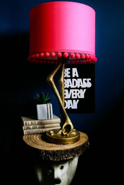 Beautiful Love Frankie Flamingo Lamp in antique gold with hot pink lampshade that i killed by adding uneven pom pom trim