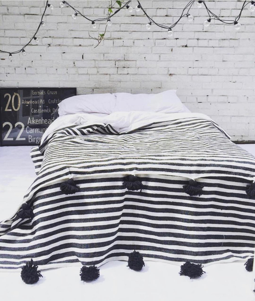 pom pom blanket in  beautiful monochrome style