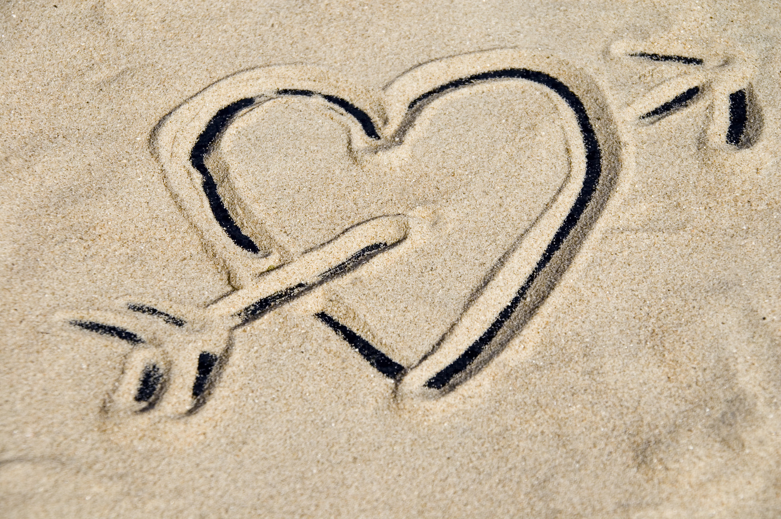 © Mamz heart depicted in sand Dreamstime
