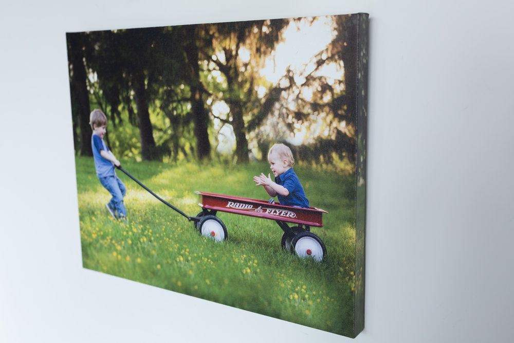 - Canvas Gallery Wrapped Image: These fun & frameless prints can go literally anywhere with any décor and come in plenty of sizes, so there is no need to figure out what the recipient's framing preference is! They display your beautiful family photos in their most natural form for a chic and modern art gallery look. Or, if you prefer a framed look, we now have the option of adding a frame to add an extra bit of style. You're gifting a piece of custom art. Help fill your loved ones' homes with endearing images. It's the ideal gift for parents, in-laws, and grandparents!