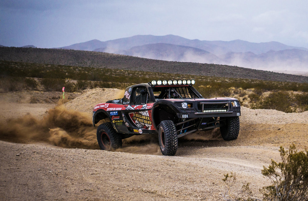 6124PJ Guglielmo - Date of Birth: 12/12/1974Hometown: Santa Ynez, CARace Vehicle: 6124 Spec TTRace Circuit(s): Best in the DesertHow long have you been racing?: 5 yearsFavorite Race Track: Mint 400Social Media: IG @childrenofthedirtCareer Highlights:2013 TrophyLite ChampBack to Back V2R winsBack to Back Mint 400 wins