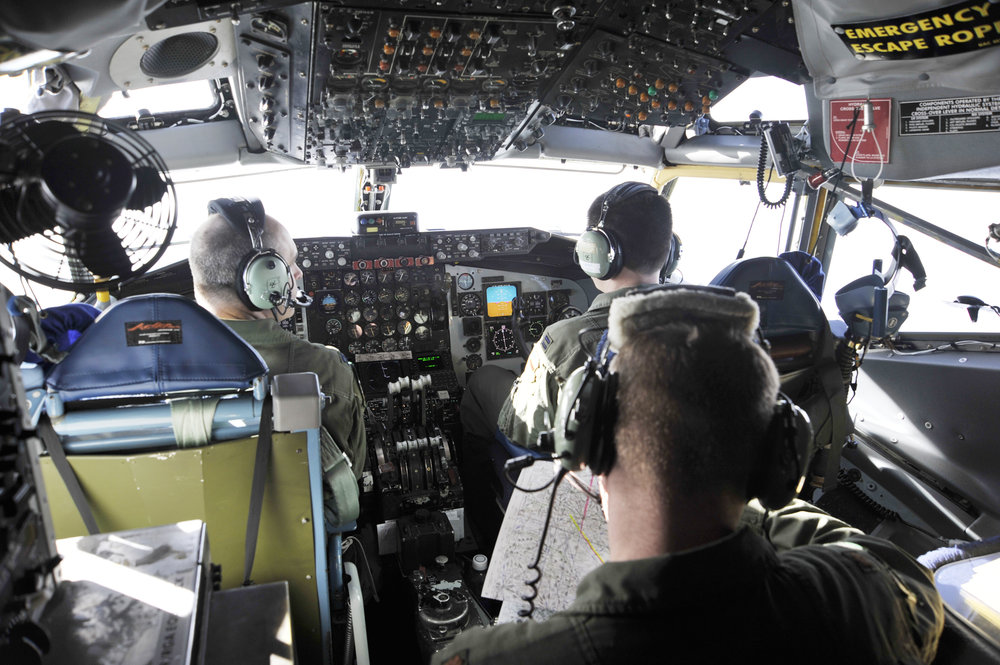 Pilots with the 45th Reconnaissance Squadron from Offutt Air Force Base, Neb., fly an OC-135 Open Skies aircraft Jan. 16, 2010, over Haiti. (Credit: U.S. Air Force)