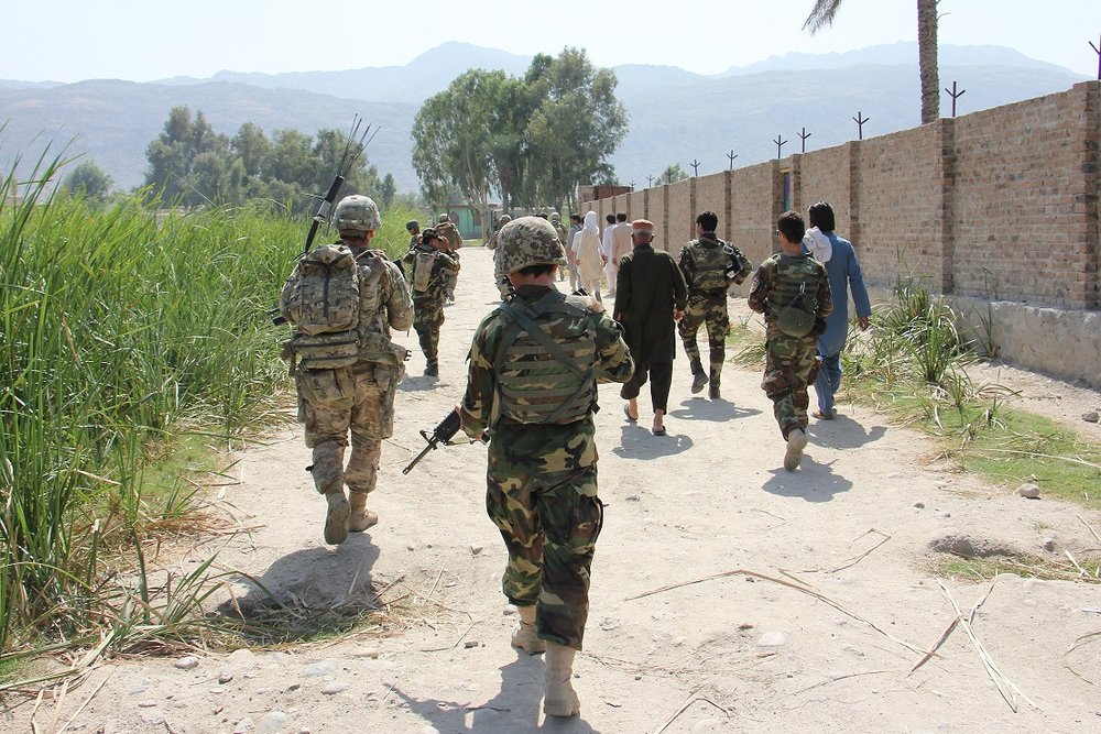 LAGHMAN PROVINCE, Afghanistan - Afghan National Army troops from 201st Corps and 3rd Brigade Combat Team, 101st Airborne Division (AASLT) soldiers assigned to Train Advise Assist Command-East enter a village during a partnered force protection patrol in Laghman province Sept. 23, 2015. (U.S. Army photo by Capt. Jarrod Morris)