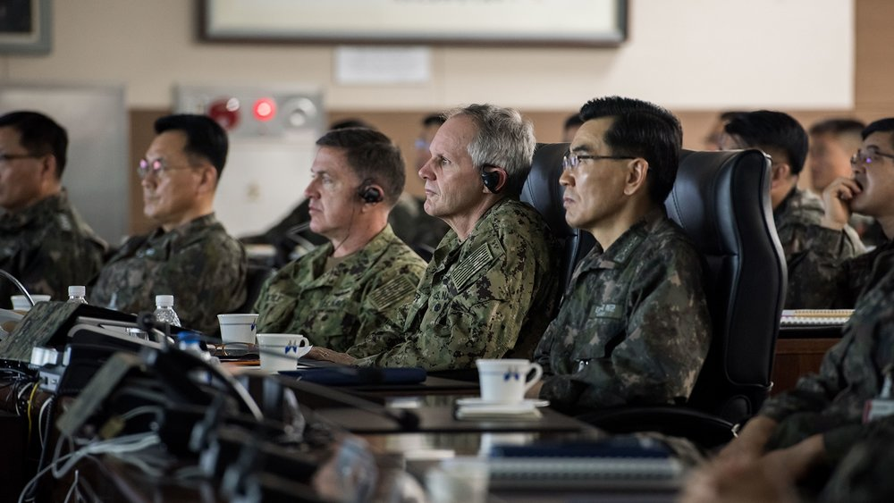 From left, Rear Adm. Michael E. Boyle, commander, U.S. Naval Forces Korea, Vice Adm. Phillip G. Sawyer, commander, U.S. 7th Fleet, and Republic of Korea (ROK) Navy Vice Adm. Jung, Jin-sup, commander, ROK Fleet, sit for a combined ROK-U.S. briefing. (Feb. 28, 2018)