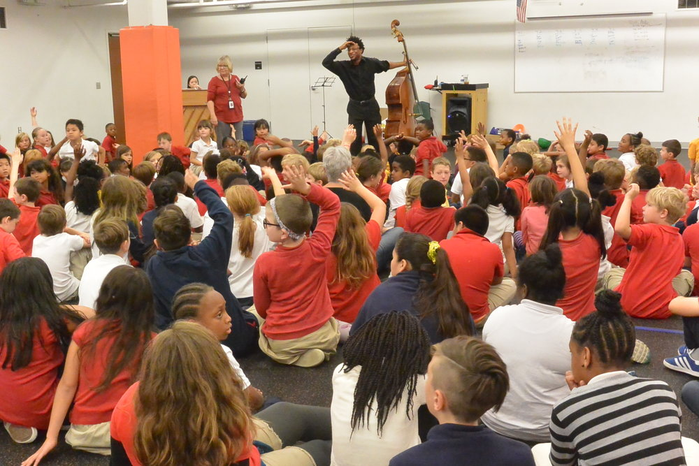 Double bassist Xavier Foley performed for students at Crossroads Academy – Central Street, KC MO