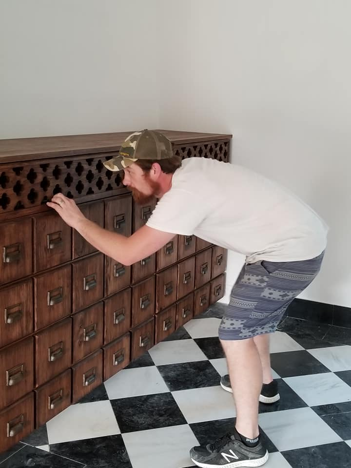 "GORGEOUS card catalog style entertainment center, designed by Craig and Nicolette and built by Craig. The card catalog style drawers are faux and open into several large functional drawers and cupboards. Decorative top grate piece by ""Little Red's Big Signs""."