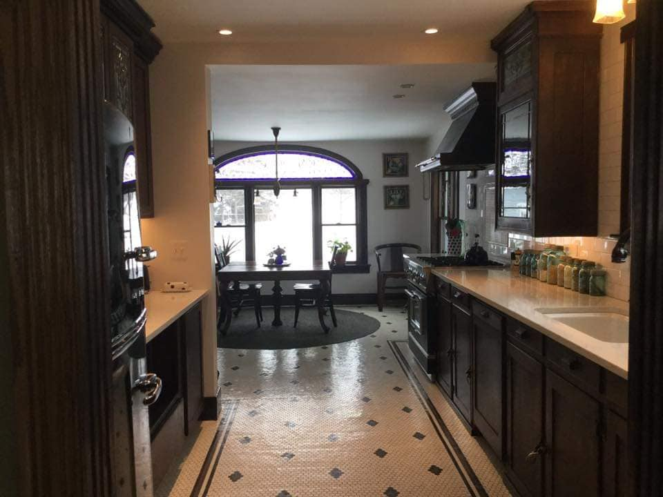 Design consulting by Nicolette, on this gorgeous kitchen remodel. The right side of the galley is a re-purposed 1900s bar, made into cabinets. The tile floors are a show stopper!