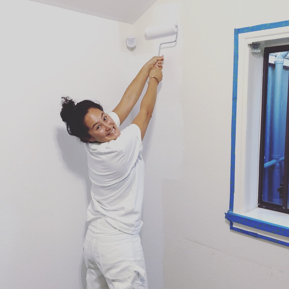 Co-Founder Jazmyne Geis is spinning the paint roller.