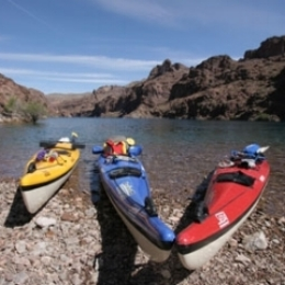 desert adventures - colorado river 3 kayaks beached.jpg