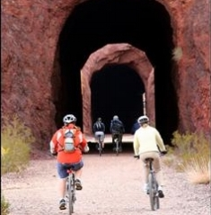 desert adventures tunnel bike 2 riders pointing by the lake.jpg