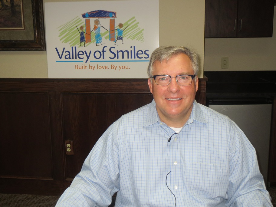 Small size version of Mother Teresa Charitable Trust Russ Lane with Valley of Smiles sign - April 2014.jpg