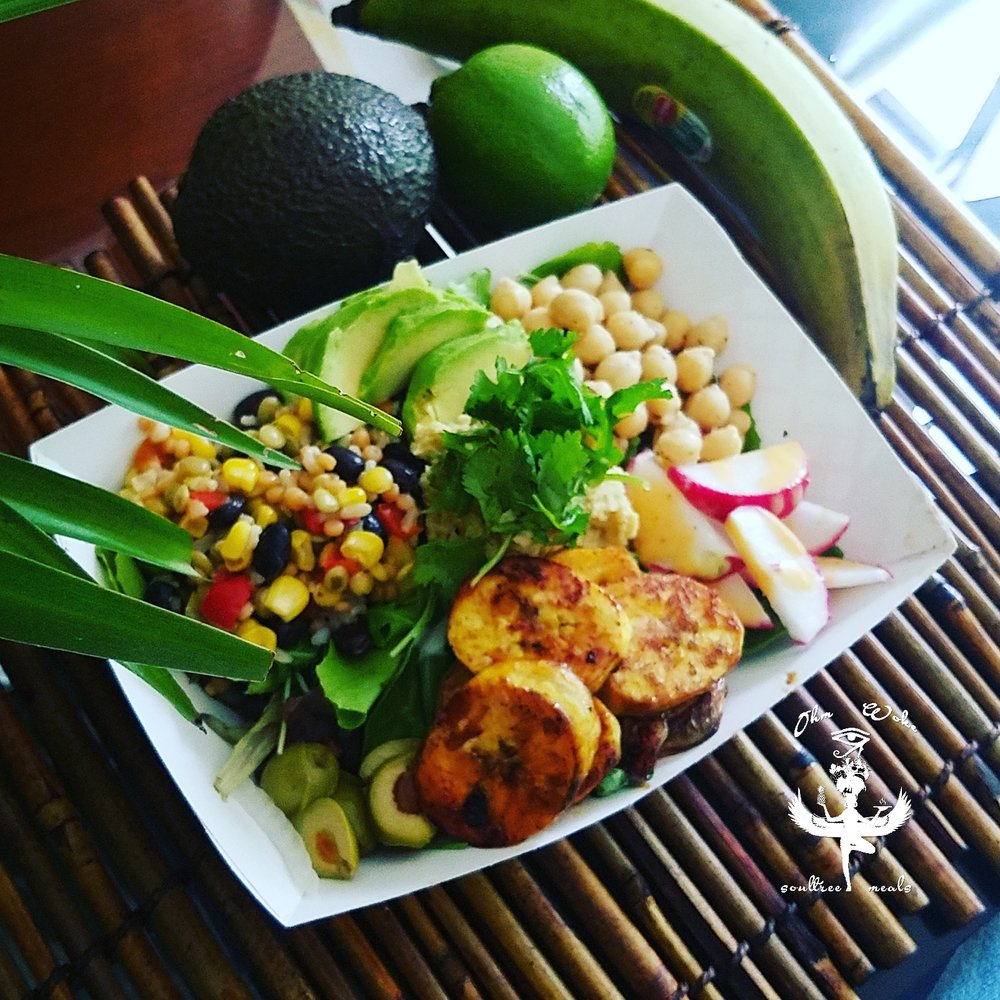 Sun Goddes Bowl - Chic Peas, green olives, radishes, black bean lentil mix, sliced avocados, plantains, topped w/cilantro on a bead of greens.