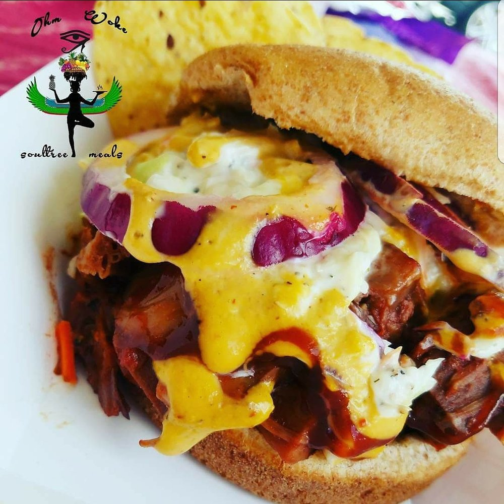 Pulled smoked BBQ Jack Fruit Sammich - This mouth watering Pulled Jack Fruit Sandwich will have your palate reciting rhymes. Smoked Jackfruit, homemade vegan BBQ sauce, topped with  garden fresh Red onions and our special sauce Slaw! Don't worry, we'll look away when you lick your fingers!