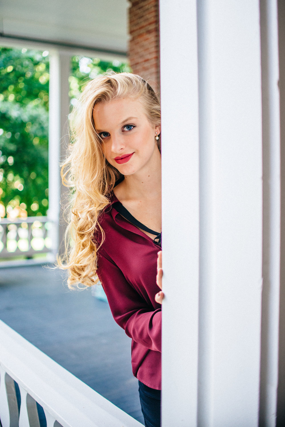 Blonde senior model with long curly hair flipped to one side