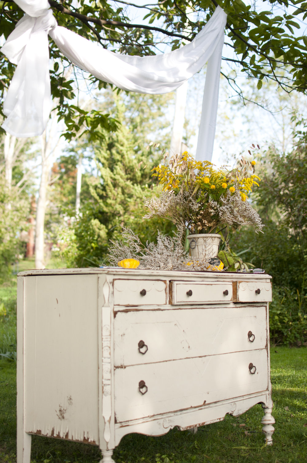 antique dresser used as altar for outdoor wedding ceremony