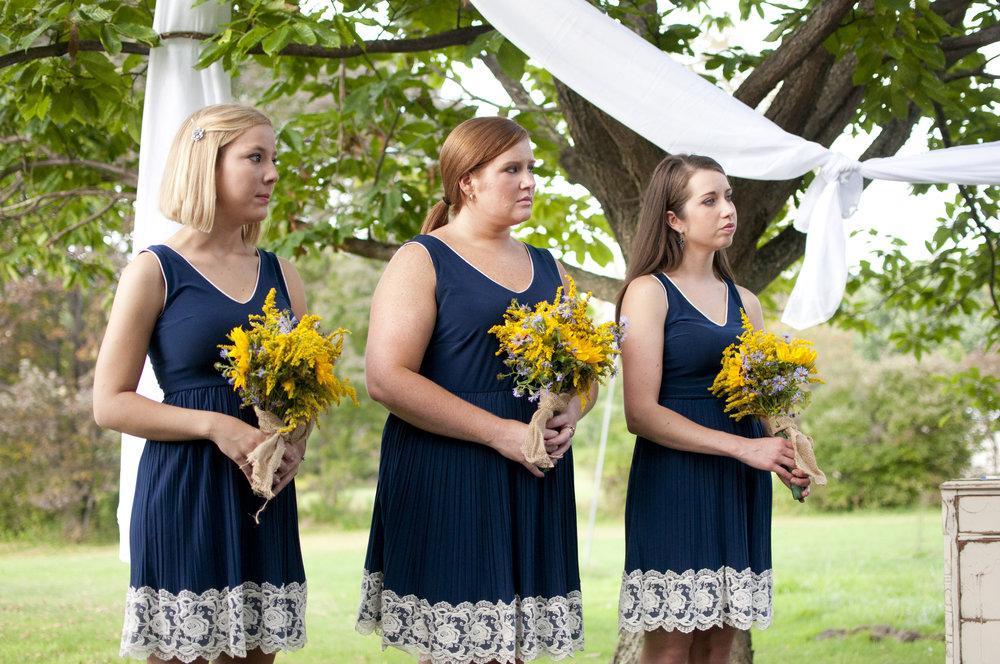 bridesmaids wearing navy blue mod cloth dresses for bridal party