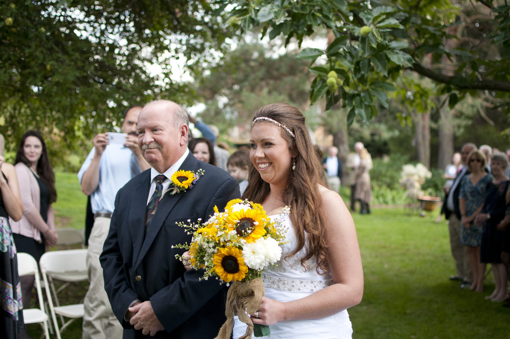 father walking bride down the aisle at her outdoor ceremony at La Ferme Rouge in Patton PA