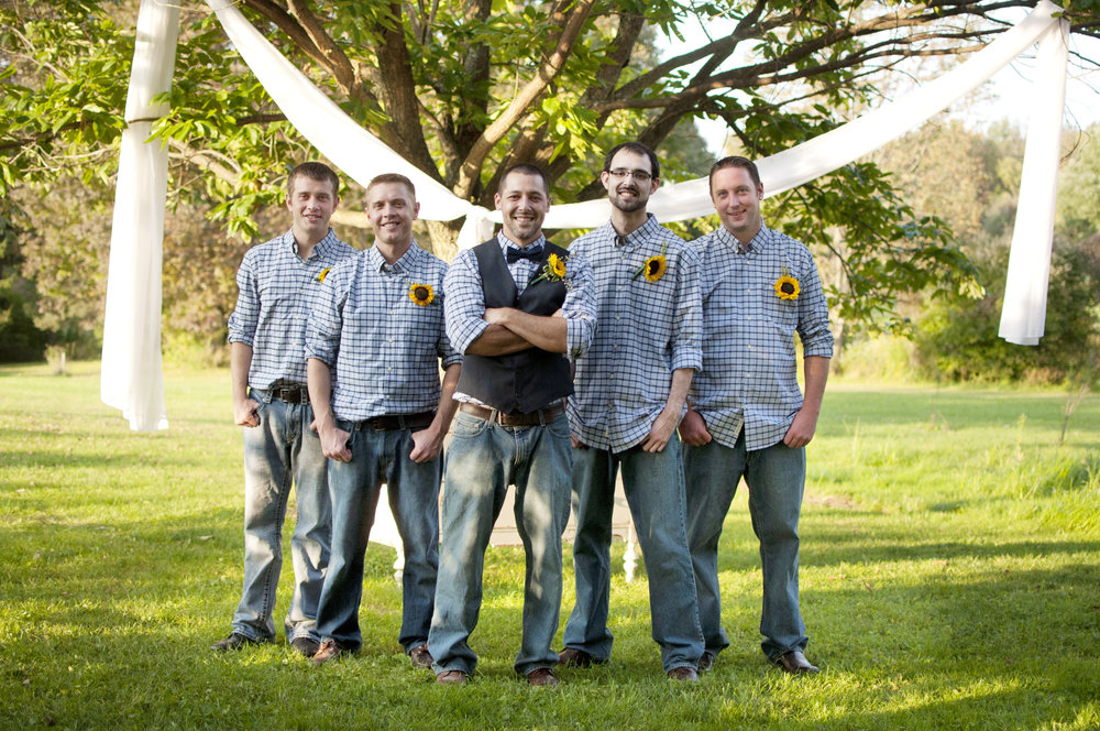 Groomsmen wearing jeans with sunflower boutineers