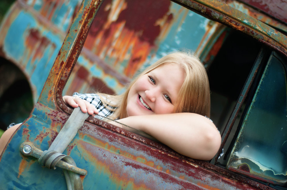 blonde high school senior model in vintage car with petina