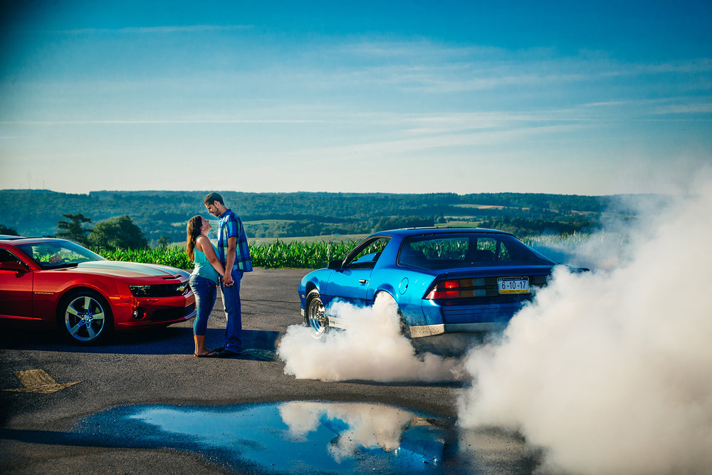 engagement photo with old camaro smoking tires-2.jpg